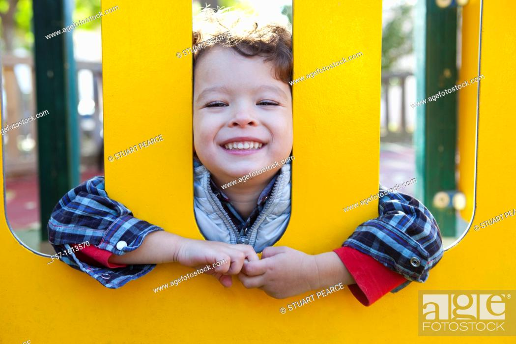 Stock Photo: 3 year old boy playing in a playground.