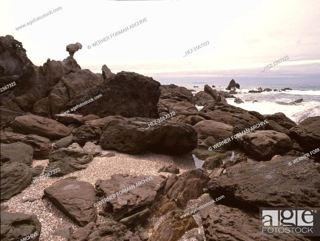 Stock Photo: Rocks on the beach below Mount Maunganui, at the entrance to Tauranga harbour. Country of Origin: New Zealand. Place of Origin: North Island.
