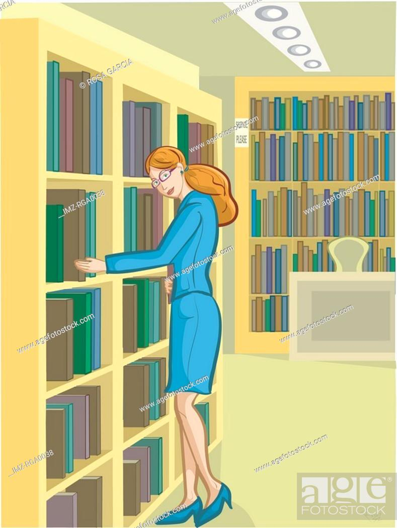 Stock Photo: A librarian arranging books on the shelves.