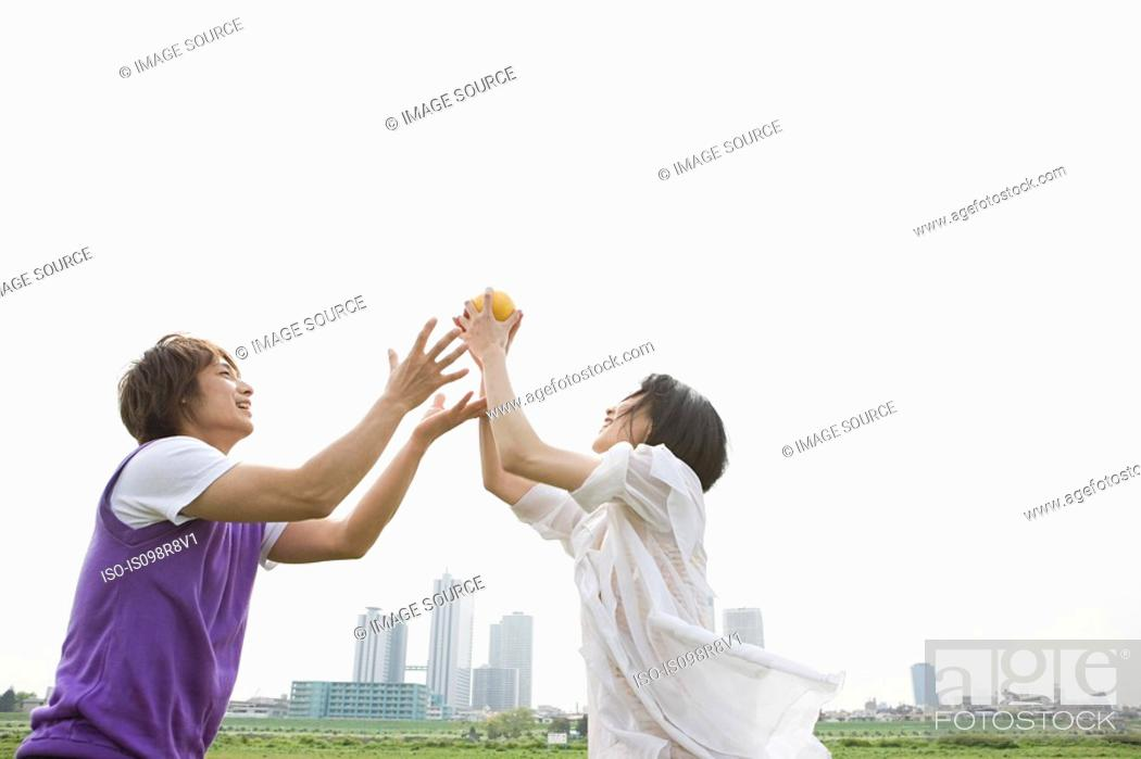 Stock Photo: Young couple playing ball game.