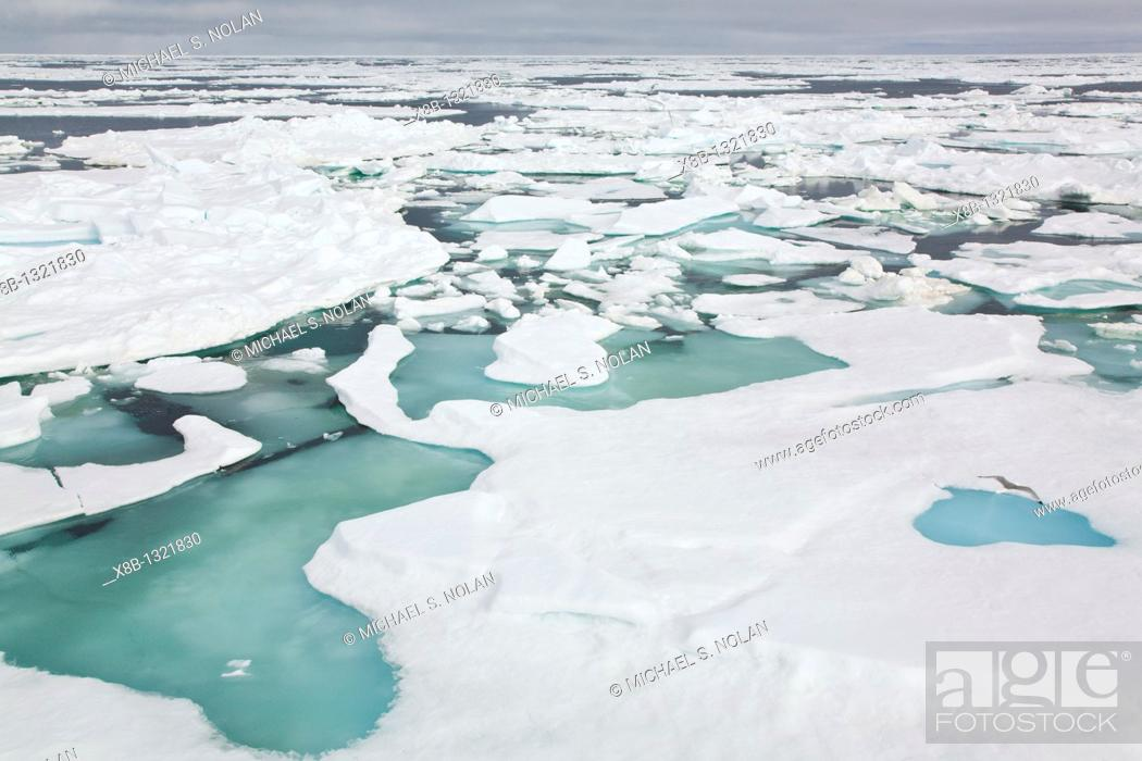 Stock Photo: Open leads surrounded by multi-year ice floes in the Barents Sea between Edgeoya Edge Island and Kong Karls Land in the Svalbard Archipelago, Norway.