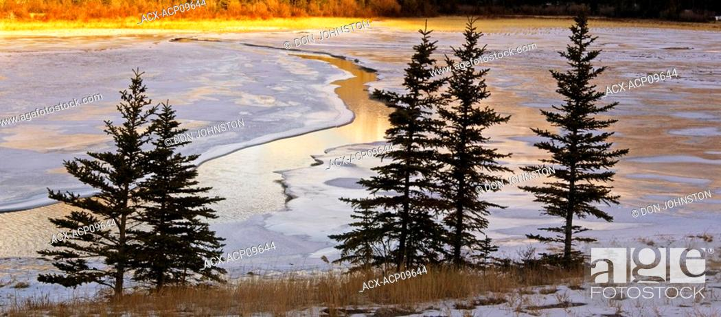 Stock Photo: DeSmet Range reflected in open ice and water channel of Jasper Lake, Jasper National Park, Alberta, Canada.