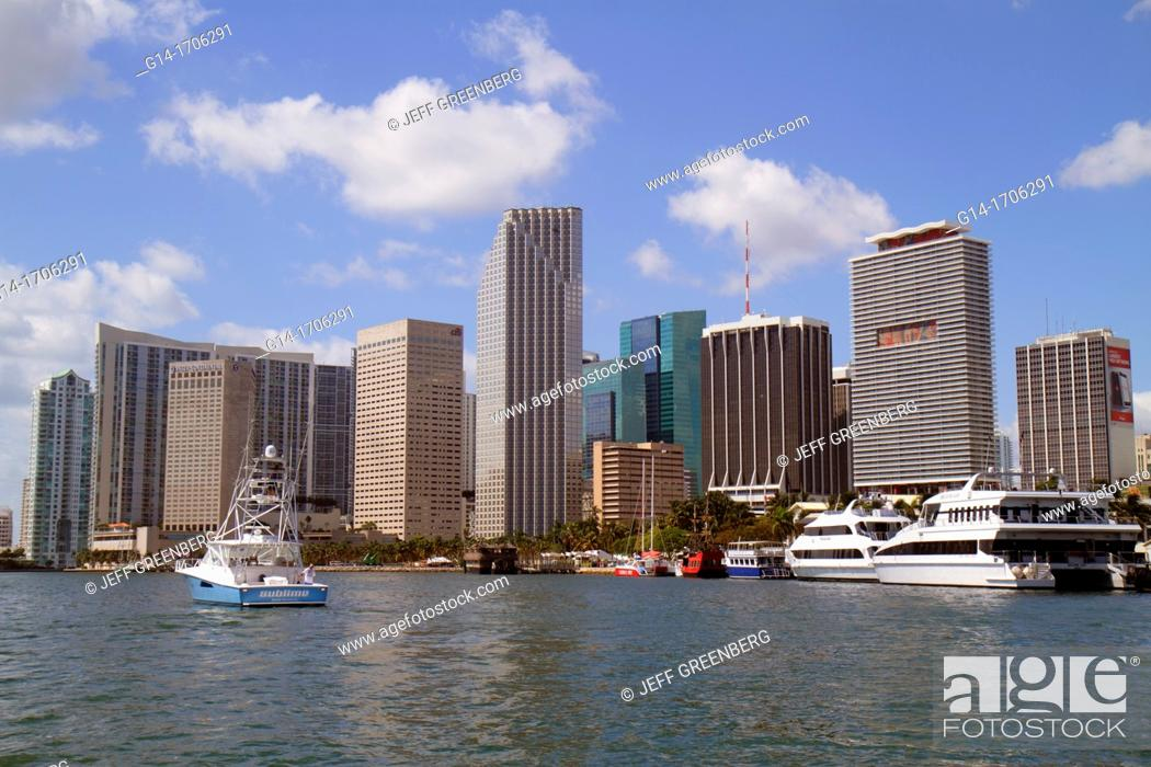 Stock Photo: Florida, Miami, Biscayne Bay, downtown skyline, office, condominium, buildings, hotels, boats, water, Southeast Financial Center, centre, ferries,.