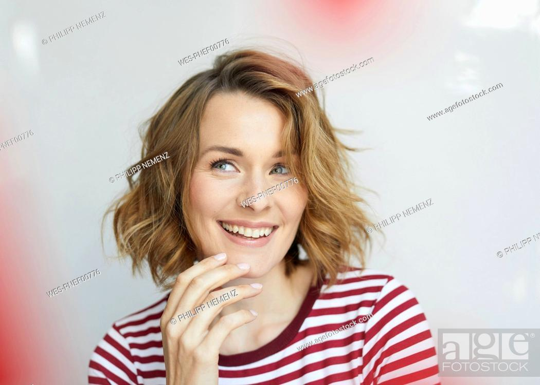 Stock Photo: Portrait of smiling woman wearing red-white striped t-shirt.