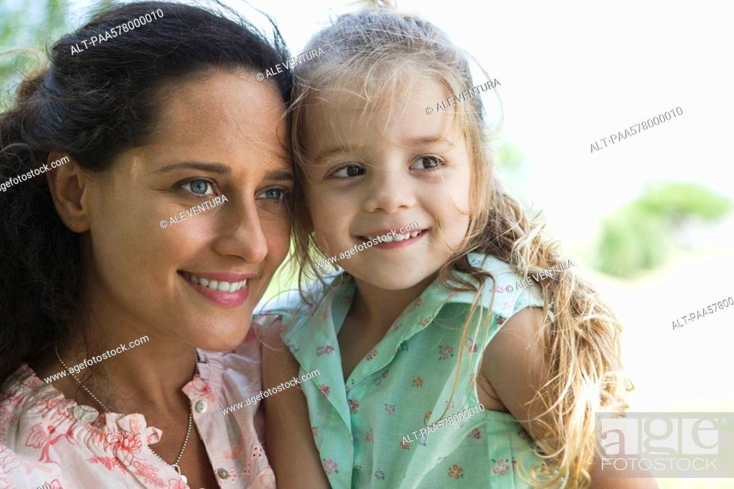 Stock Photo: Mother and daughter together outdoors, portrait.