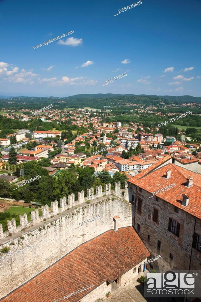 Stock Photo: Italy, Lombardy, Lake Maggiore, Angera, La Rocca fortress, walls and town overview.