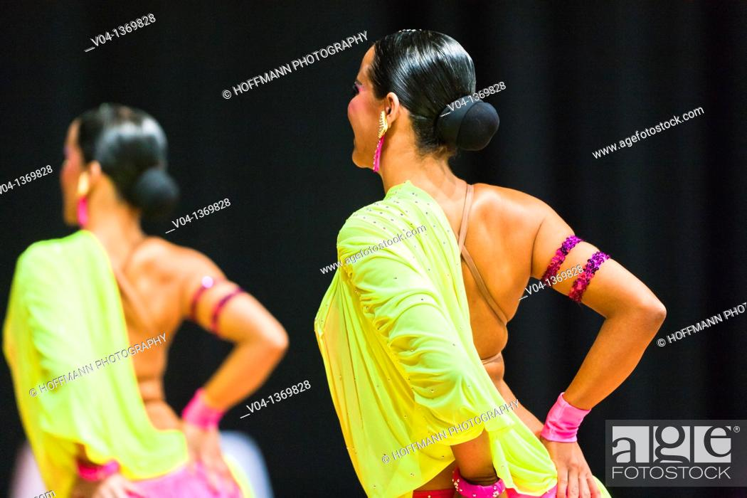 Stock Photo: Back of female dancers at a dancing competition, Germany, Europe.