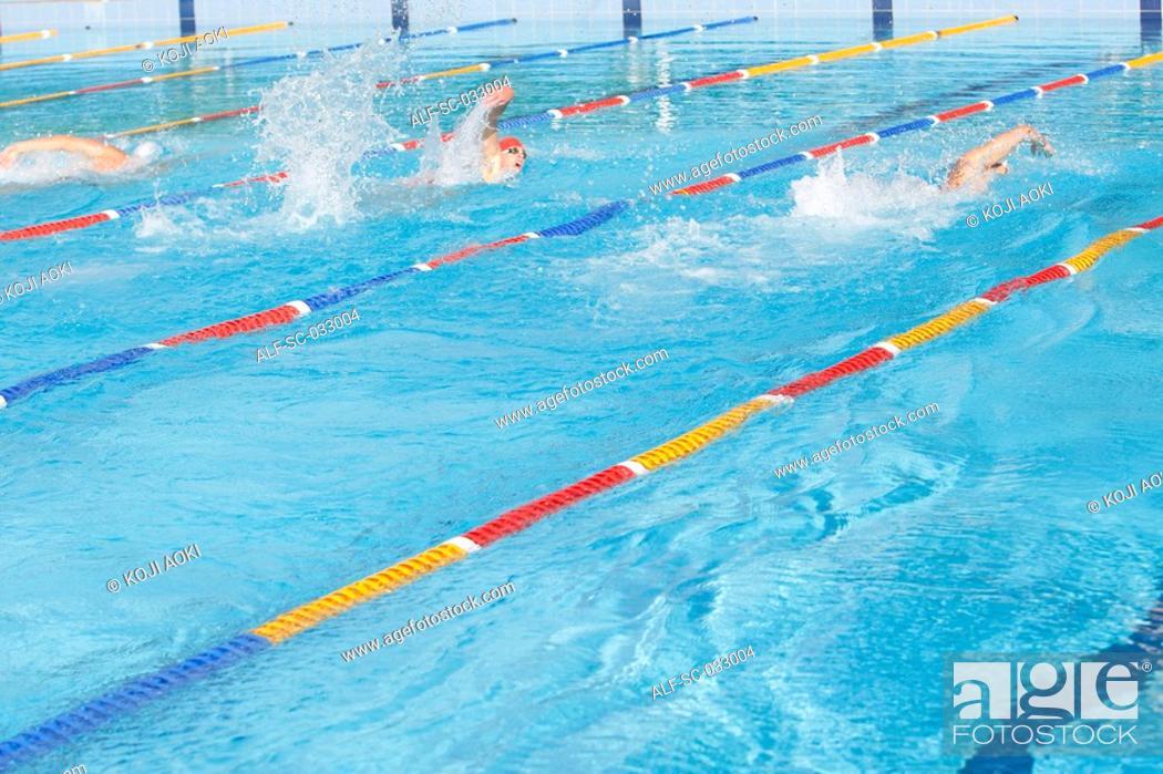 Stock Photo: Three australian swimmers competing.