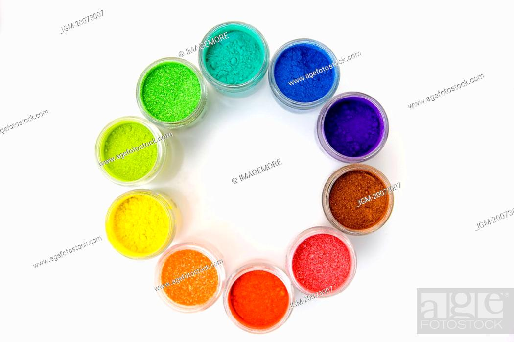 Stock Photo: Different colors of paint in jars forming a circle.