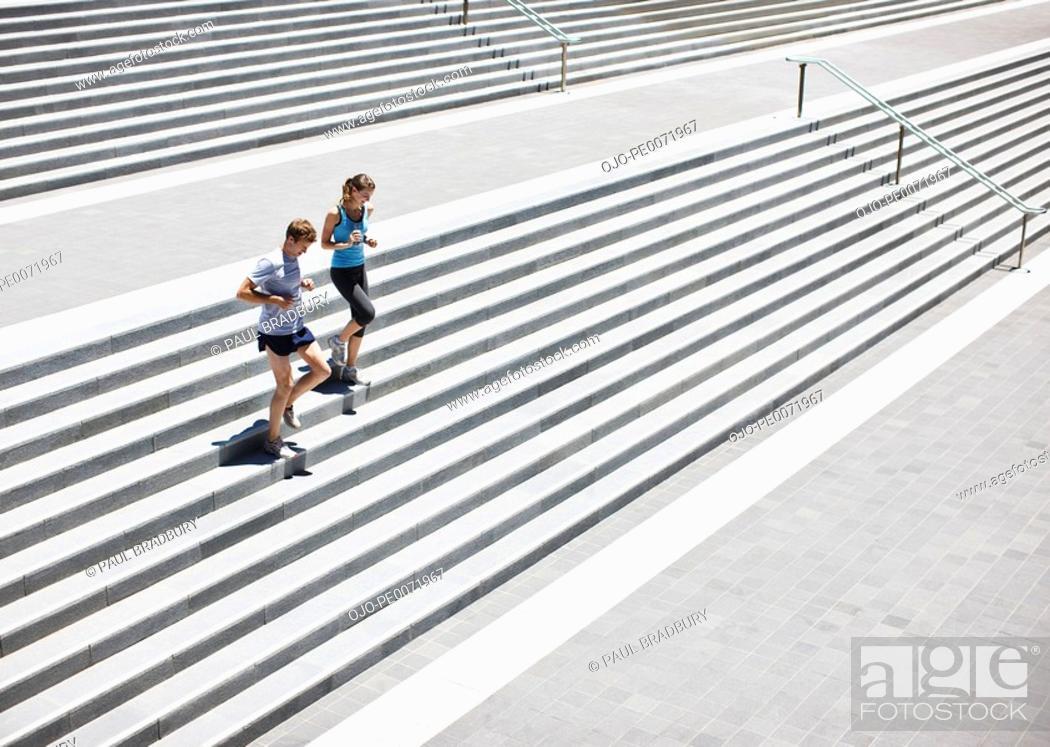 Stock Photo: Runners running down stairs.