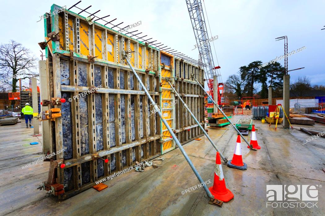 Stock Photo: Supported formwork around poured concrete walls on building site.