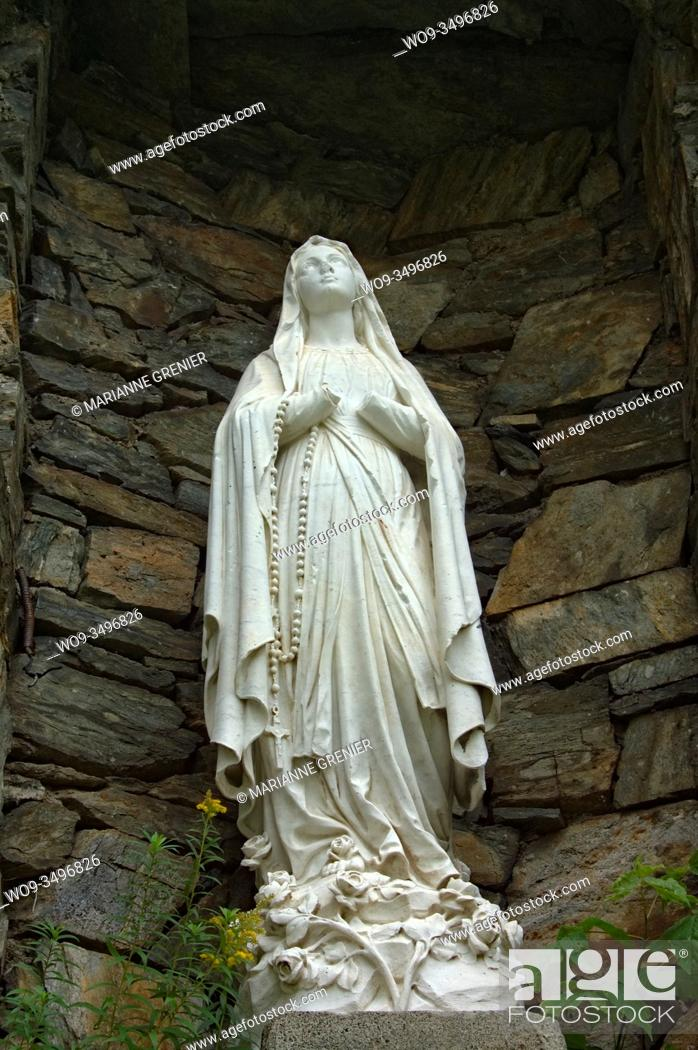 Stock Photo: A picture of the Virgin Mary's statue taken in Immaculee-Conception church bottom view in color, Sherbrooke, Quebec, Canada.