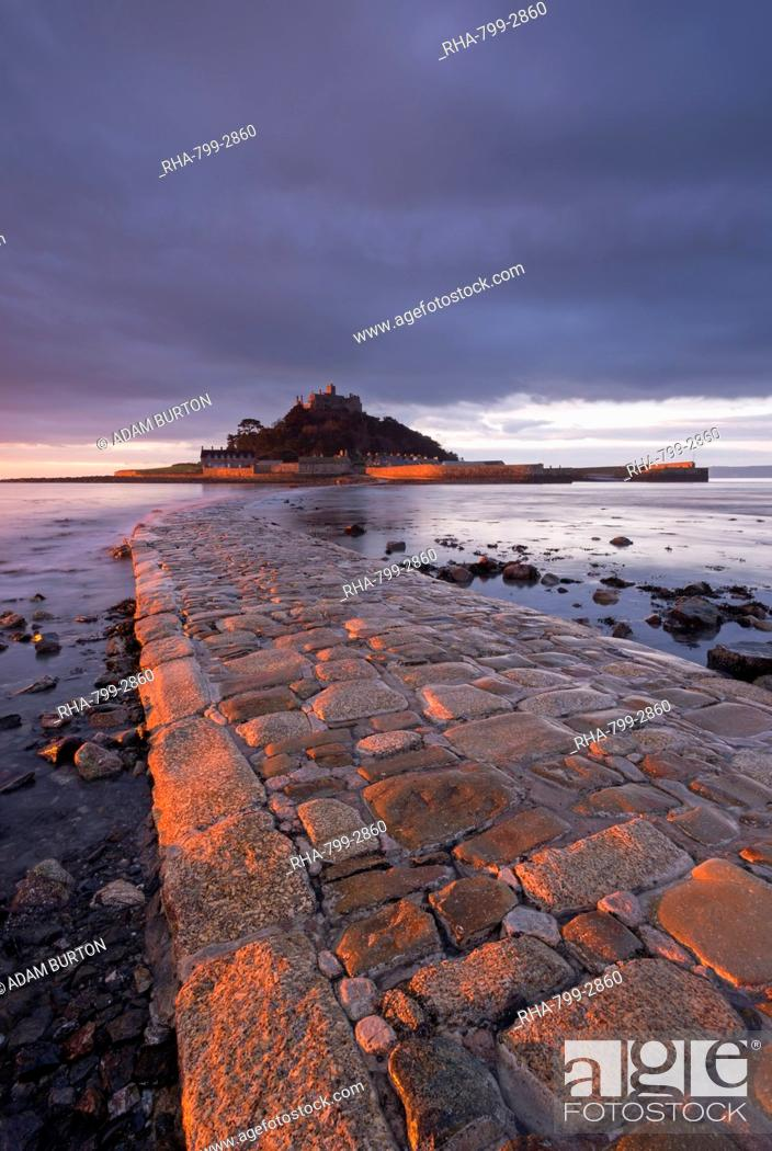 Stock Photo: First light of day in winter on the stone causeway leading to St. Michaels Mount, Marazion, Cornwall, England, United Kingdom, Europe.