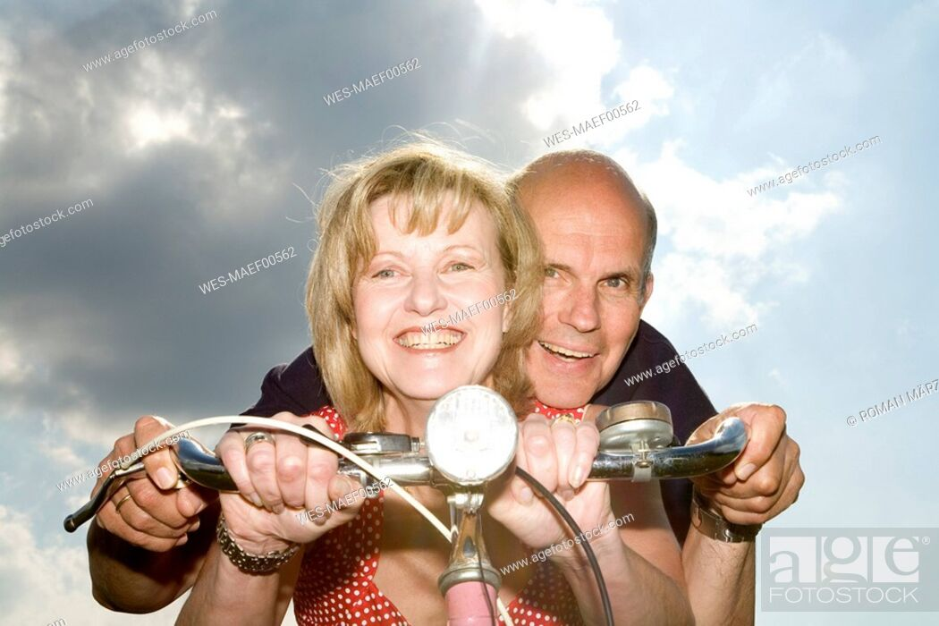 Stock Photo: Mature couple riding bike.