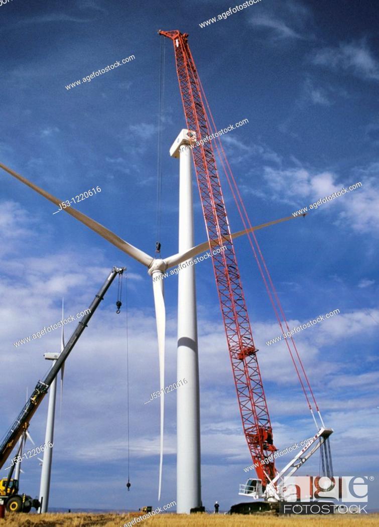 Stock Photo: Large crane lifting rotor for wind turbine at Klondike Wind Power Project, Wasco, Oregon, August 2009.