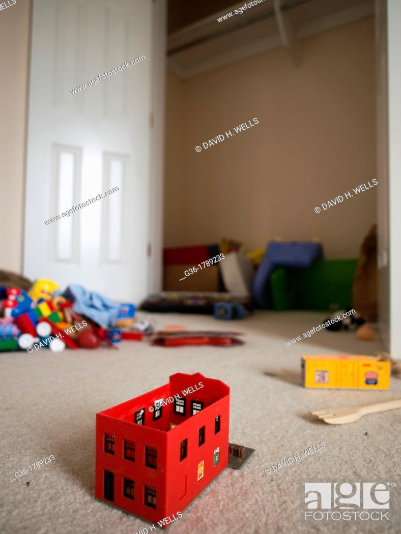 Stock Photo: Red toy left in family room inside of a foreclosed home in Talahassee, Florida, United States.