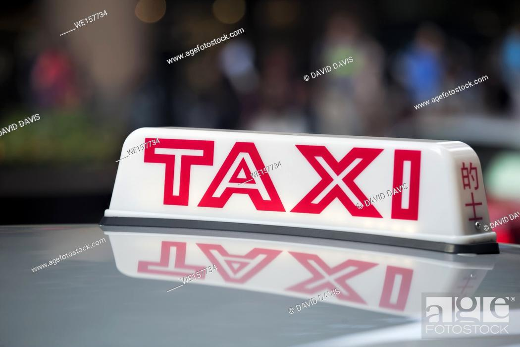 Stock Photo: Taxi cab sign on roof of a taxi in Hong Kong.