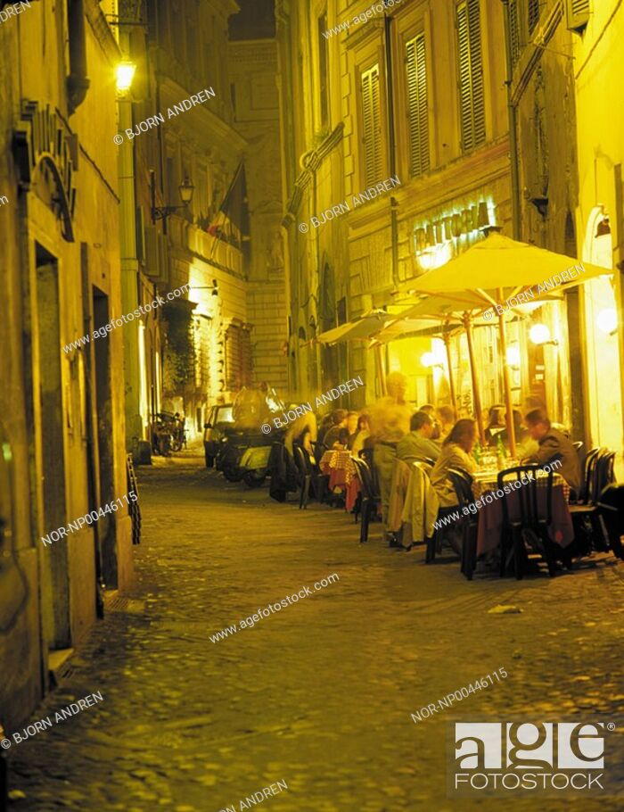 Stock Photo: View of people sitting at a restuarant and enjoying dinner.