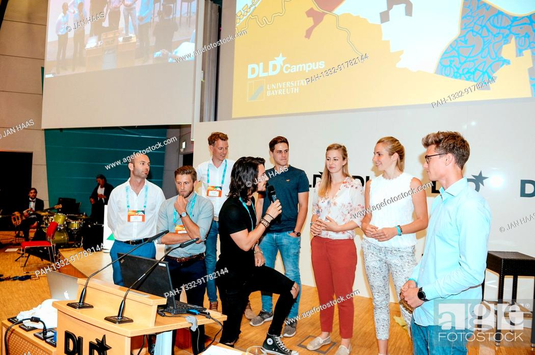 Stock Photo: BAYREUTH/GERMANY - JUNE 21: The participants of the Pitch Session are interviewed by Sven Goblirsch (Moderator & Coach) on the stage during the DLD Campus event.