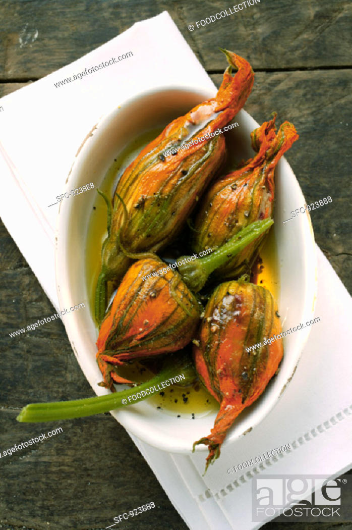 Stock Photo: Marinated stuffed courgette flowers.