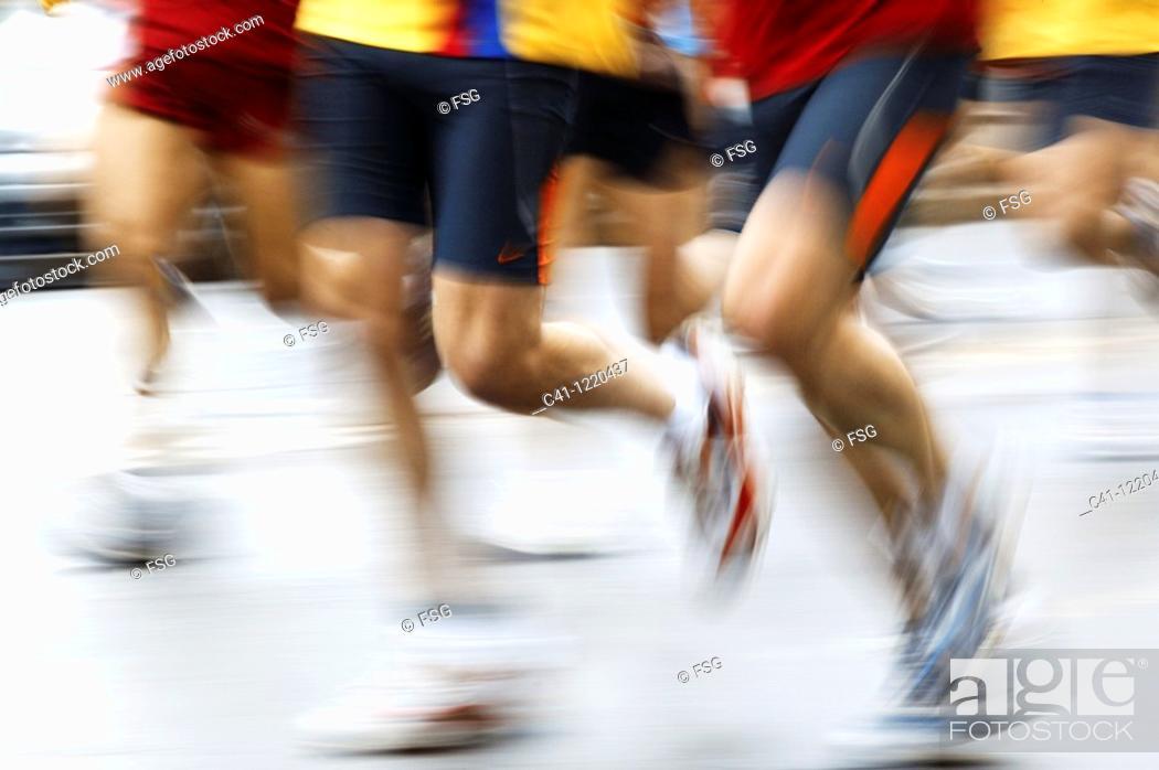 Stock Photo: People running.
