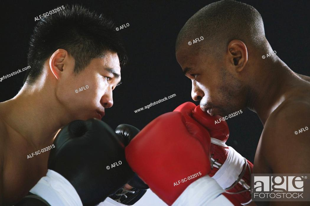 Stock Photo: Two boxers sparring.