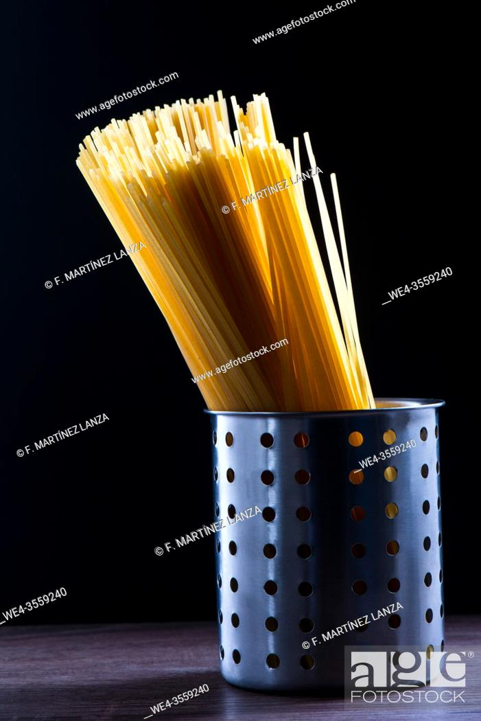 Stock Photo: Pasta of noodles inside a metal base.