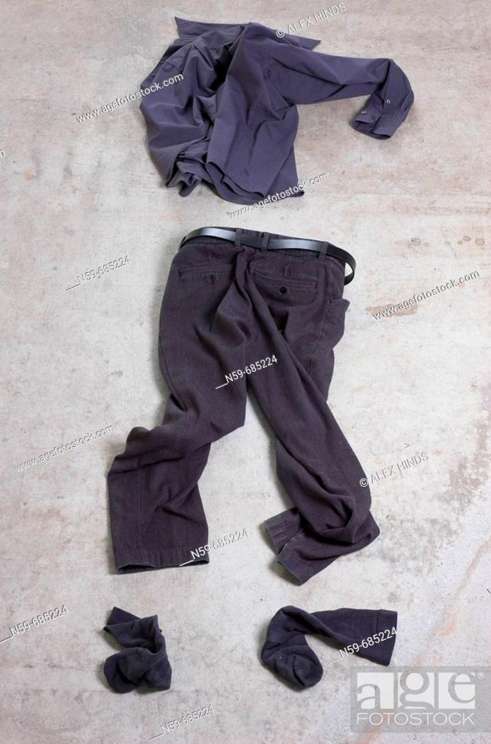 Stock Photo: Business clothing abandoned on a concrete floor.