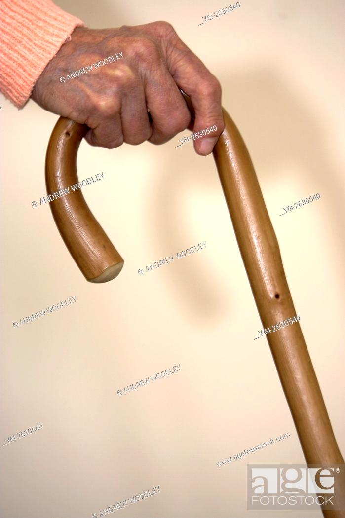Stock Photo: Elderly woman arthritic hand on walking stick.