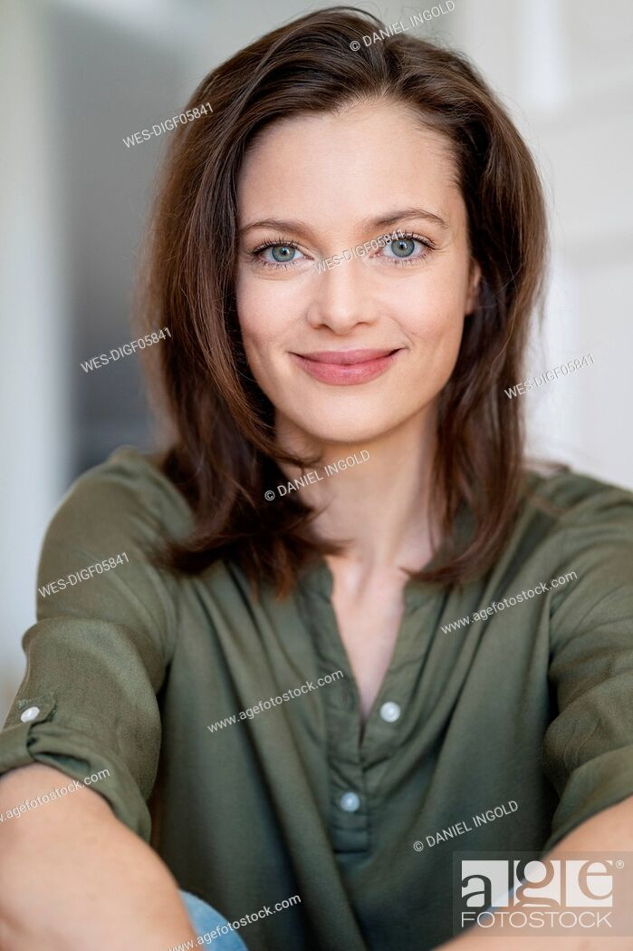 Stock Photo: Portrait of smiling woman with brown hair.