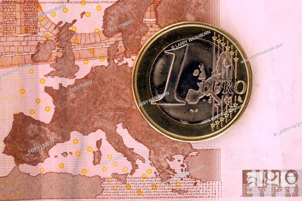 Stock Photo: Detail of a ten Euro banknote with a one Euro coin on top of it.