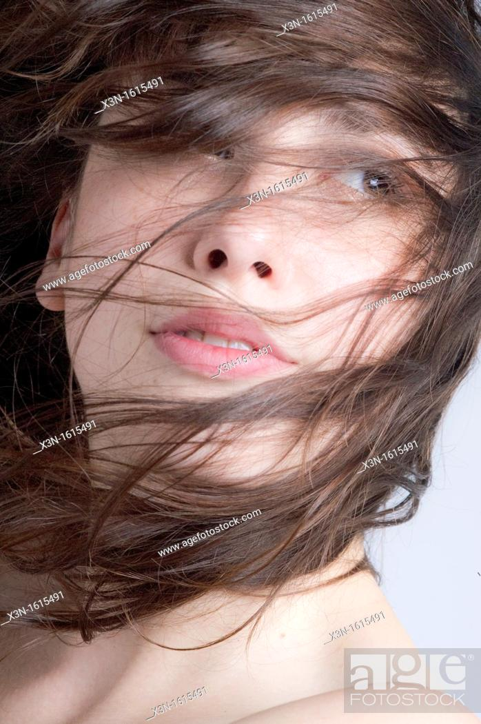 Stock Photo: Woman with hair on face.