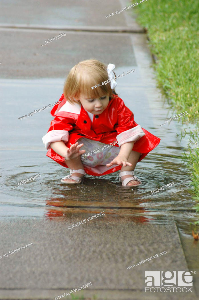 Stock Photo: Toddler playing in puddle.