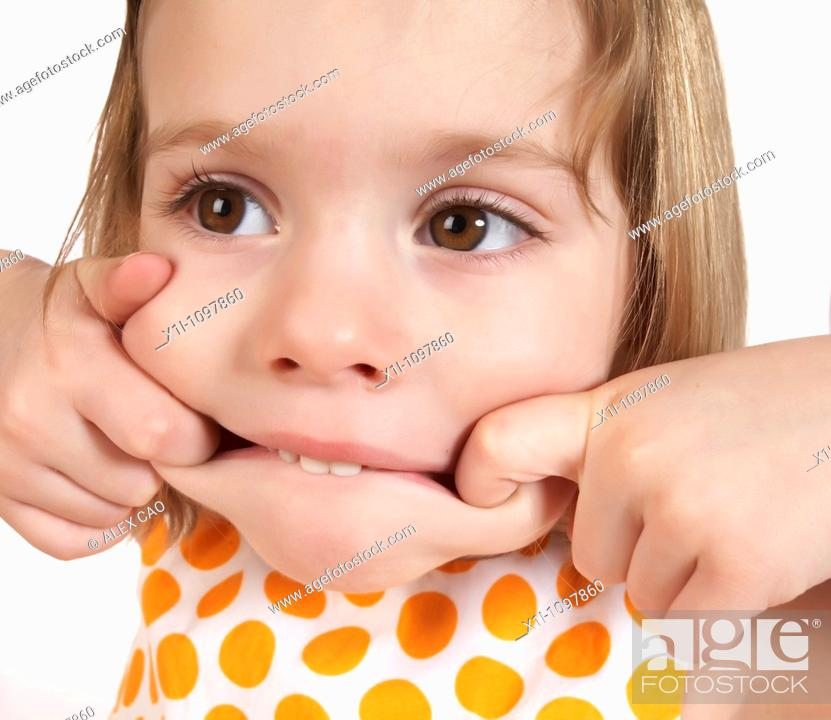 Stock Photo: Little girl pulling a face.