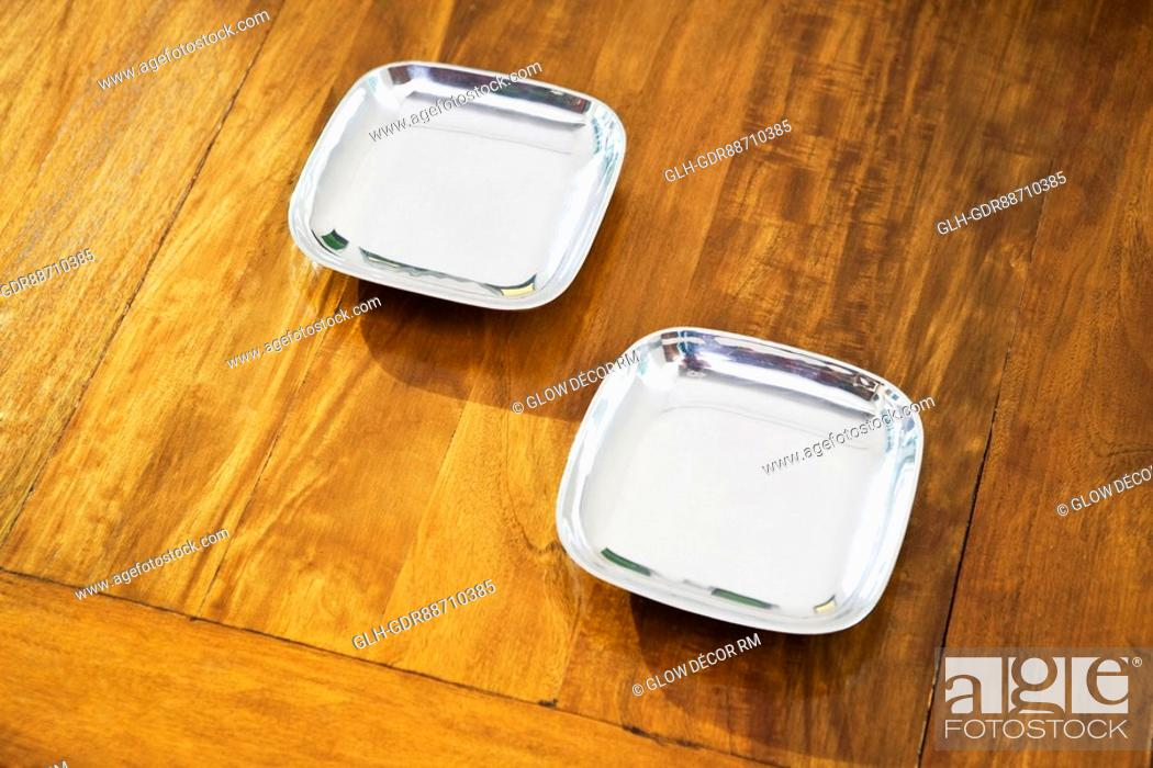 Photo de stock: Two plates on a table.