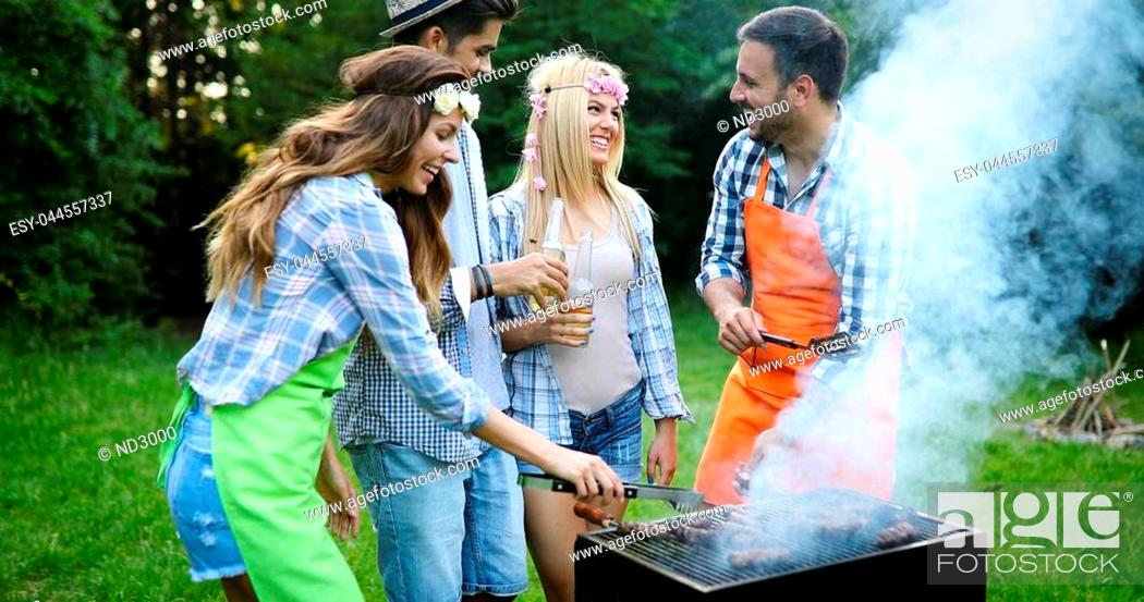 Stock Photo: Happy people having camping and having bbq party outdoor.