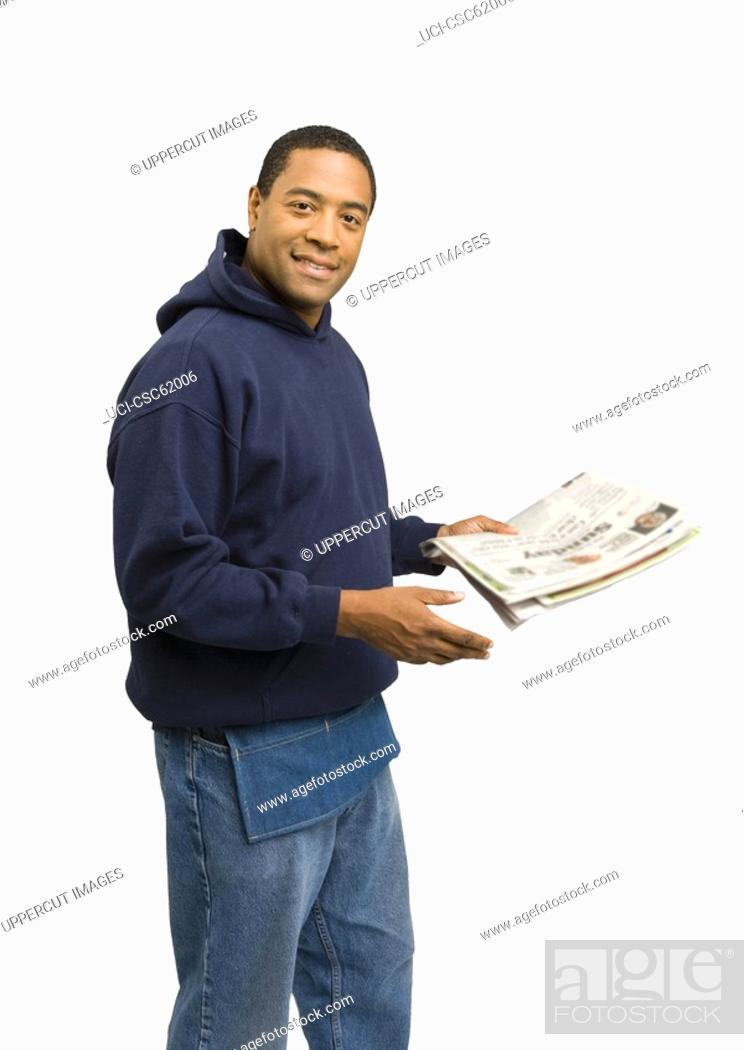 Stock Photo: Man holding newspaper.