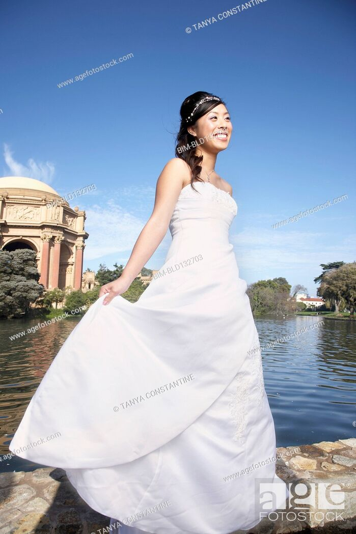 Stock Photo: Chinese bride smiling in urban park, San Francisco, California, United States.