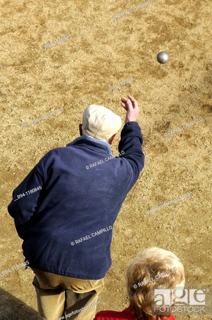 Stock Photo: People playing boules, Barcelona, Catalonia, Spain.