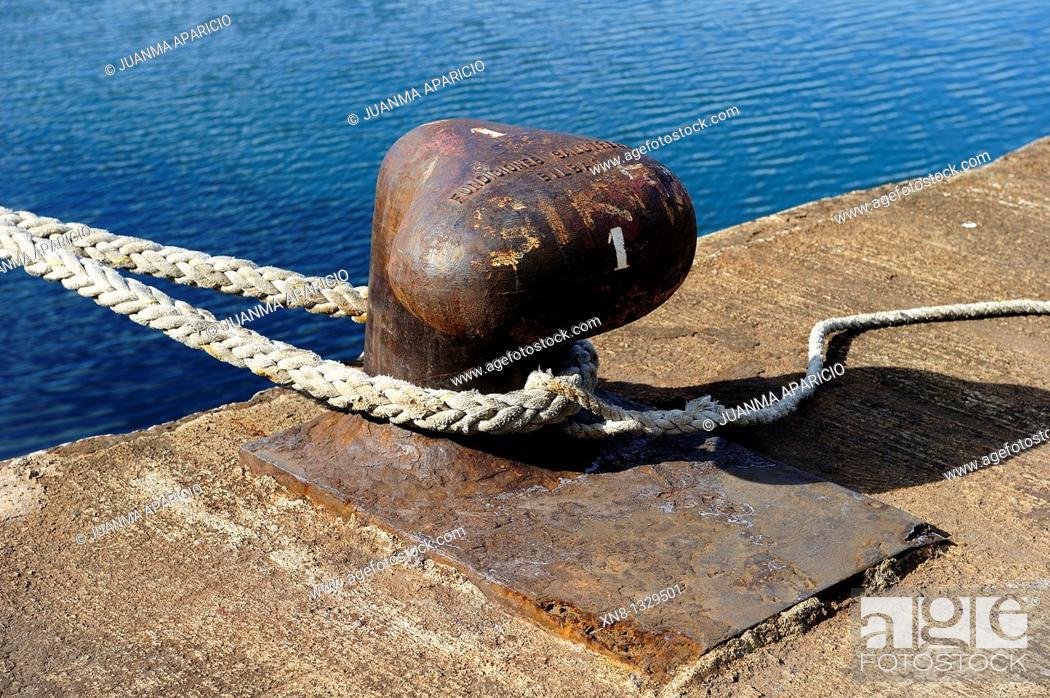 Stock Photo: Hawser attached to a Bollard.