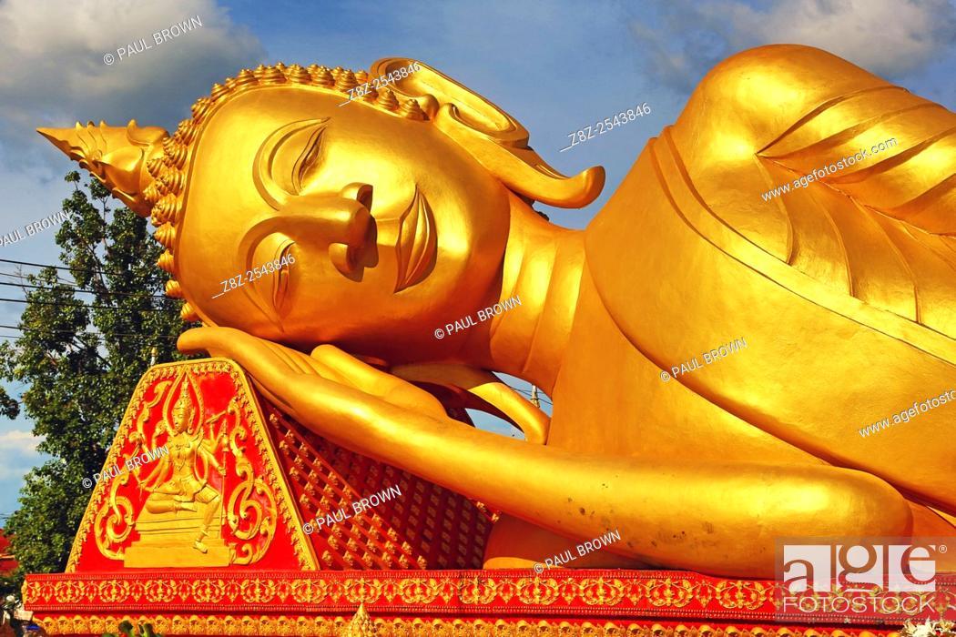 Stock Photo: Giant gold reclining sleeping Buddha statue near Wat That Luang Temple, Vientiane, Laos.