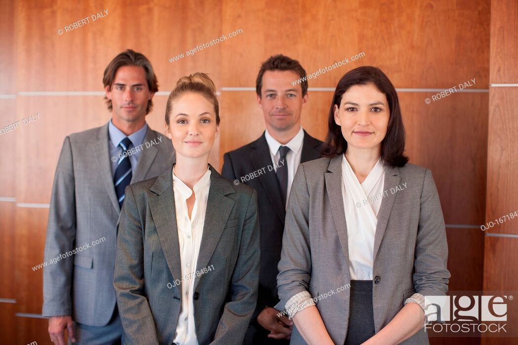 Stock Photo: Portrait of smiling business people.