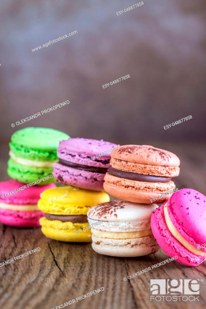 Stock Photo: Colorful macarons on the wooden background.
