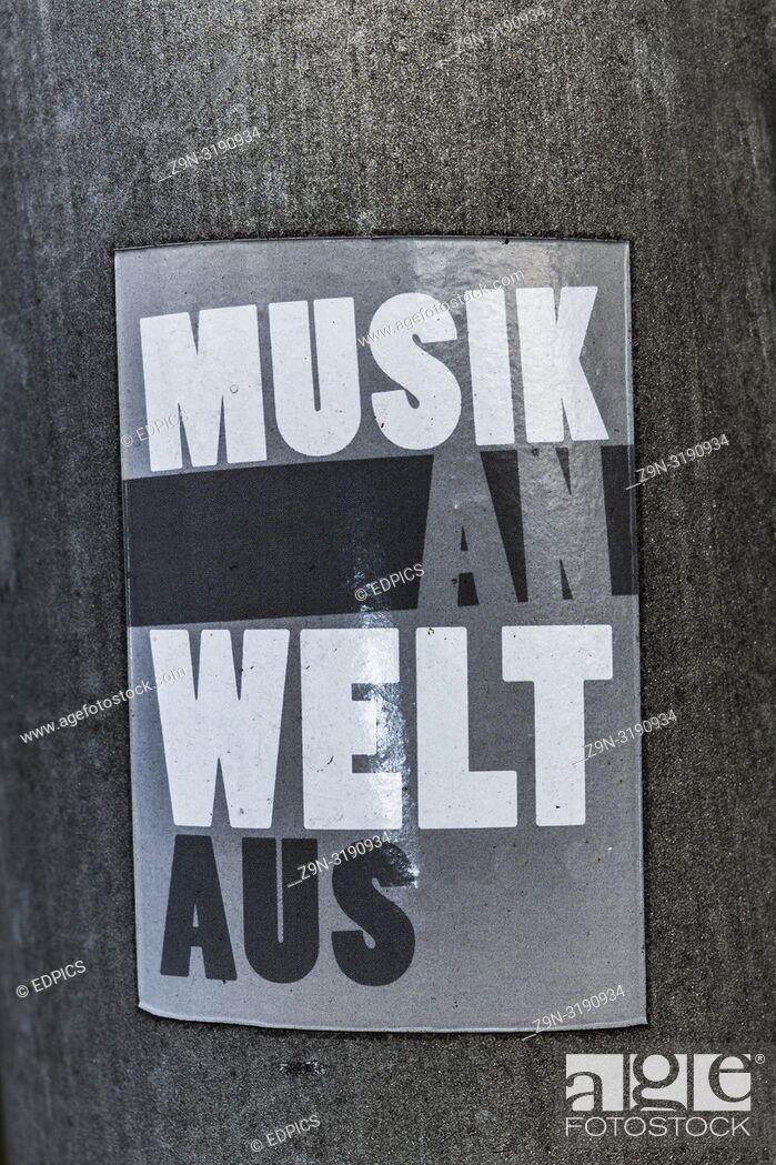 "Stock Photo: sticker saying: """"musik an, welt aus"""", """"music on, world off"""", stuttgart, baden-wuerttemberg, germany."