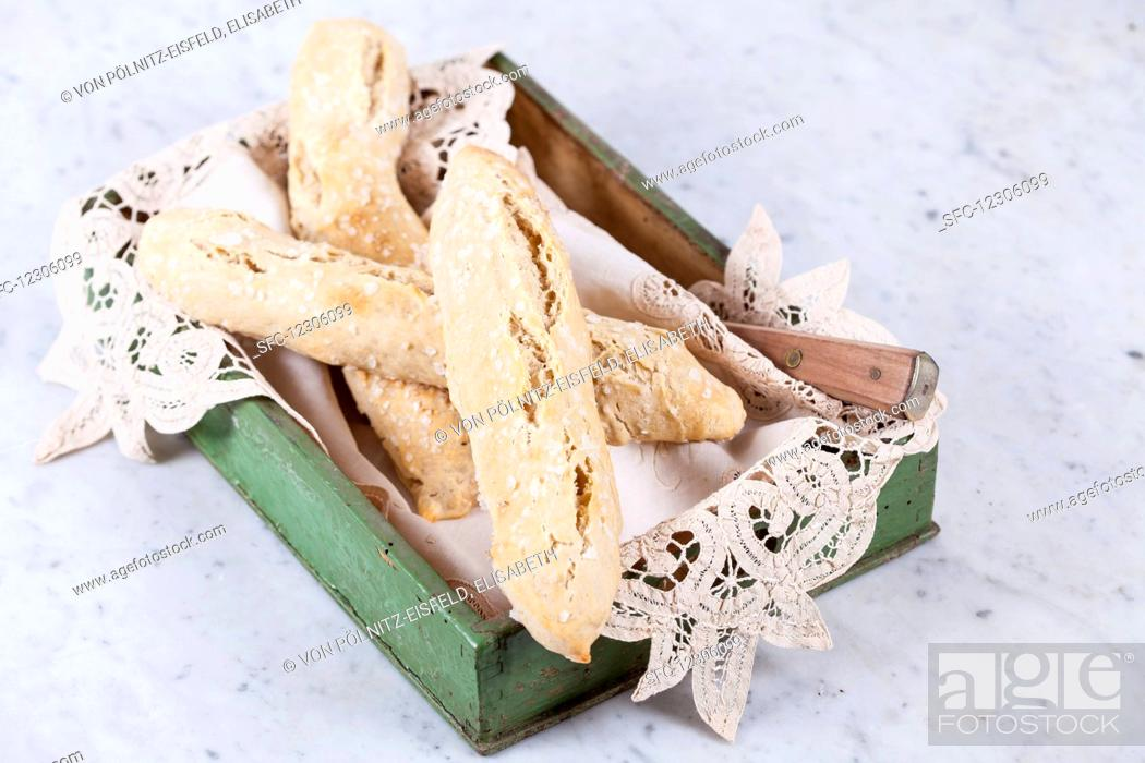 Stock Photo: Spelt salt sticks in a wooden box with a doily.
