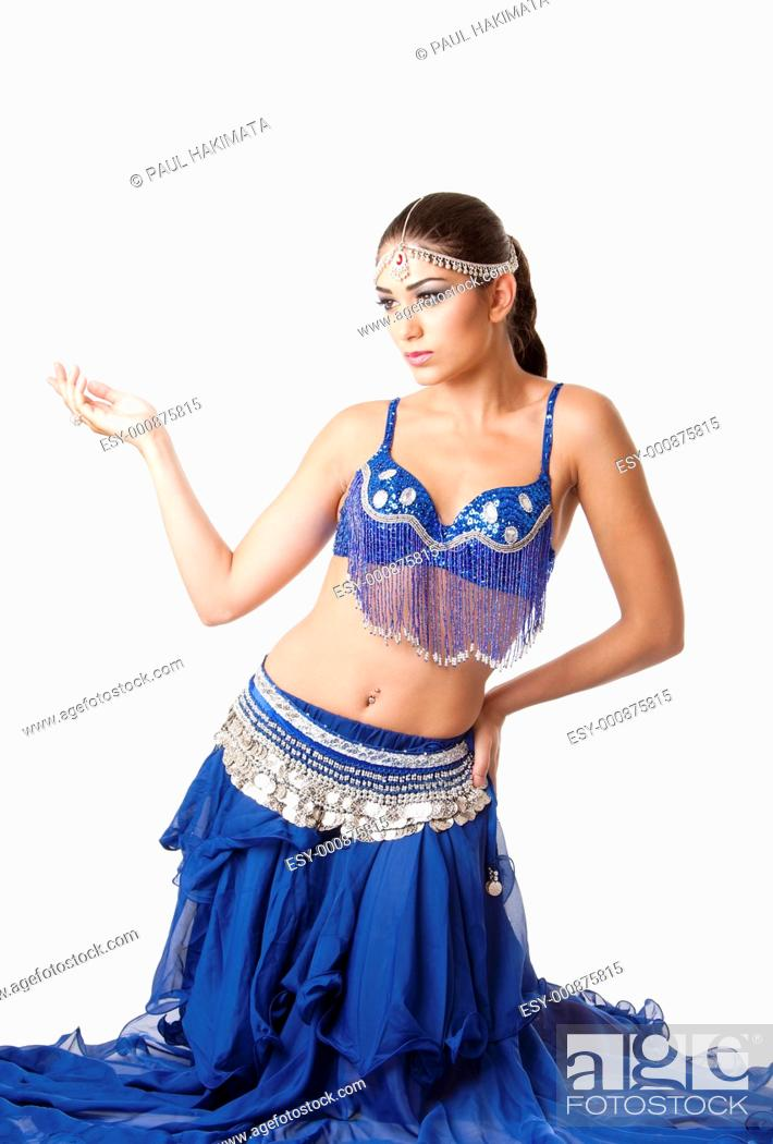 Stock Photo: Beautiful Israeli Egyptian Lebanese Middle Eastern fashion belly dancer performer in blue skirt and bra sitting on knees, isolated.