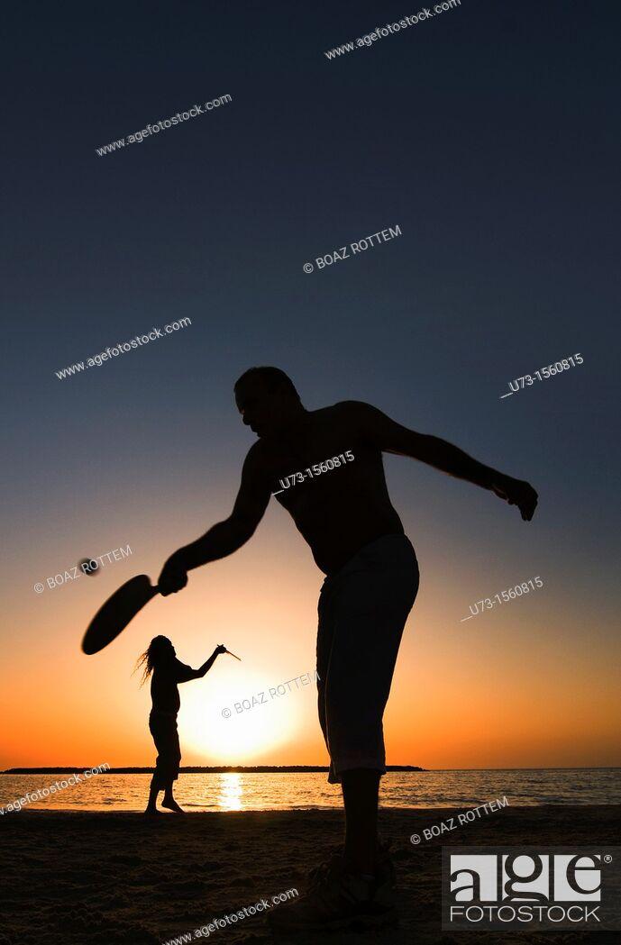 Stock Photo: Playing ' Matkot' , Israeli beach paddleball, on a beautiful afternoon on the  beach of Tel-Aviv.