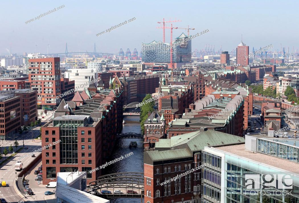 Stock Photo: The historic Speicherstadt in HafenCity with the Elbe Philharmonic Hall is pictured from a tethered hot-air balloon in Hamburg, Germany, 28May 2013.