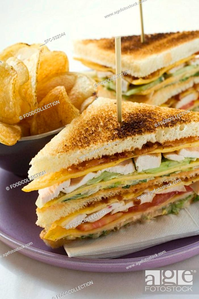 Stock Photo: Club sandwiches with chicken breast, crisps.