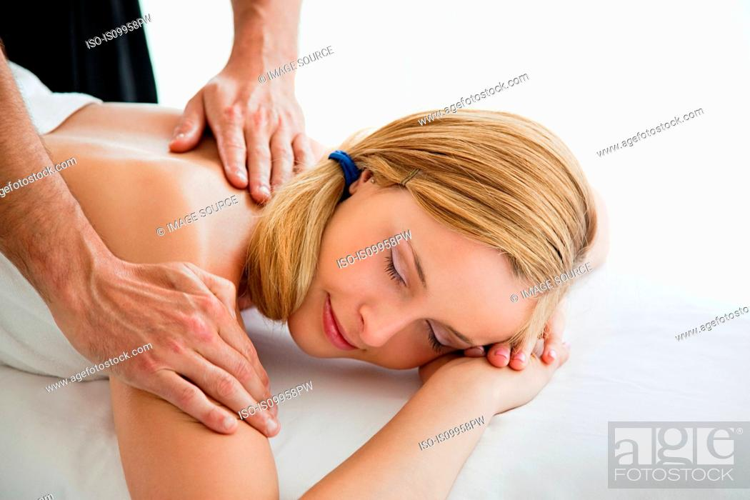 Stock Photo: Young woman being massaged.